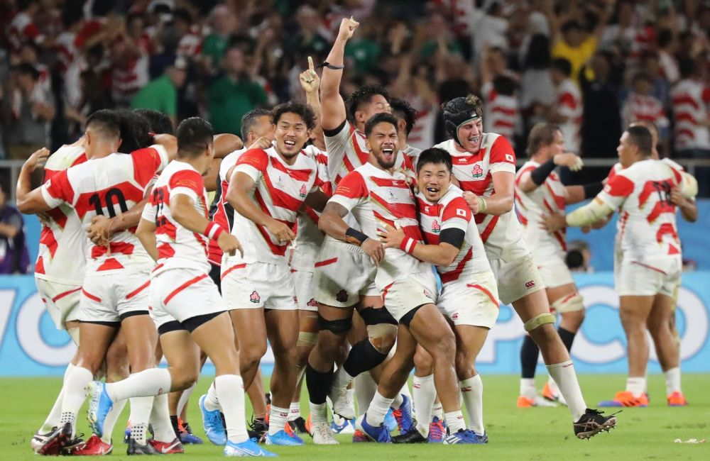 Japanese players celebrate their victory over Ireland at the 2019 Rugby World Cup