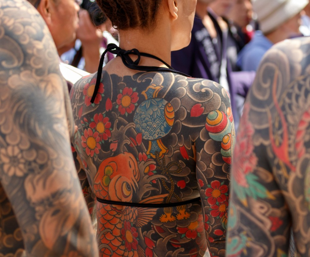Participants at a traditional Japanese festival wear their tattoos with pride