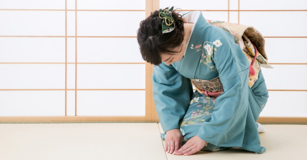 Bowing while kneeling is a common display of welcome or appreciation.