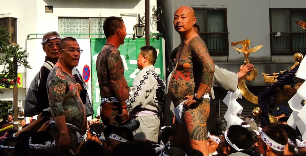Gambling is often associated with the Yakuza, recognizable by their extensive tattoos.