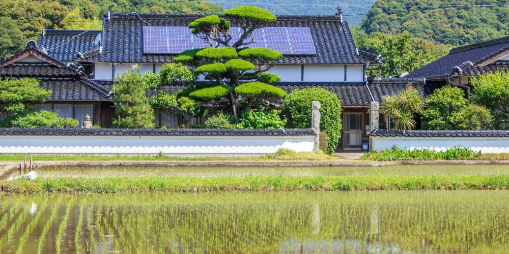 A traditional Japanese farm house is equipped with solar panels.