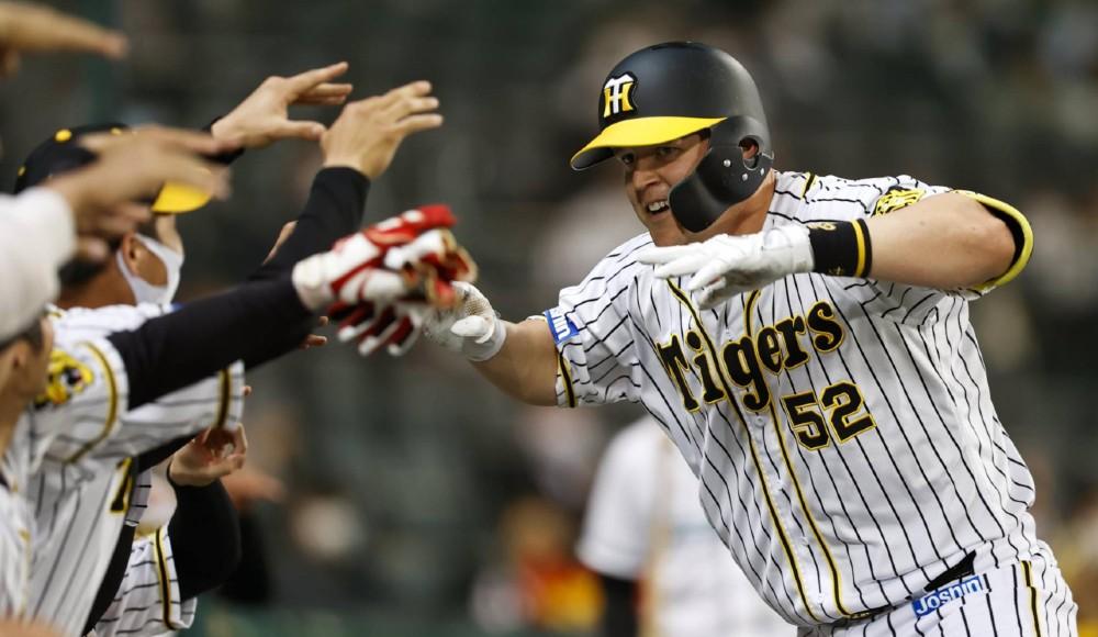Hanshin Tigers #52 Jerry Sands celebrating a homerun.